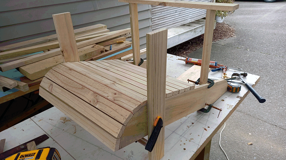 legs being fixed to an adirondack chair