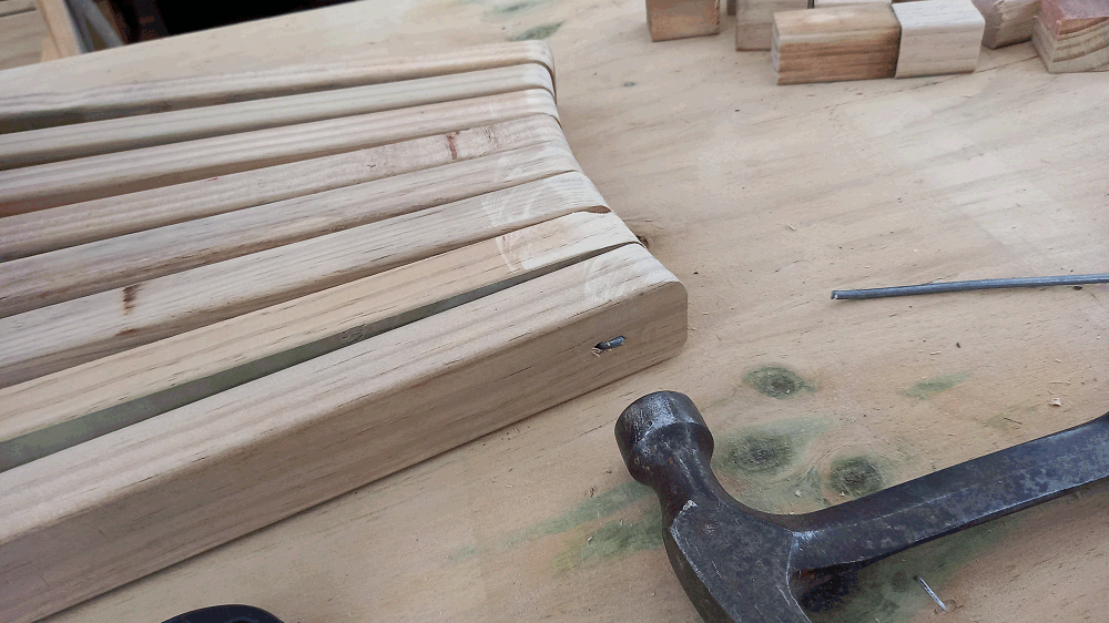 camoda chair construction - the wiree being hammered down