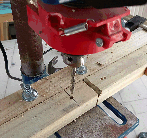 camoda chair construction - holes being drilled