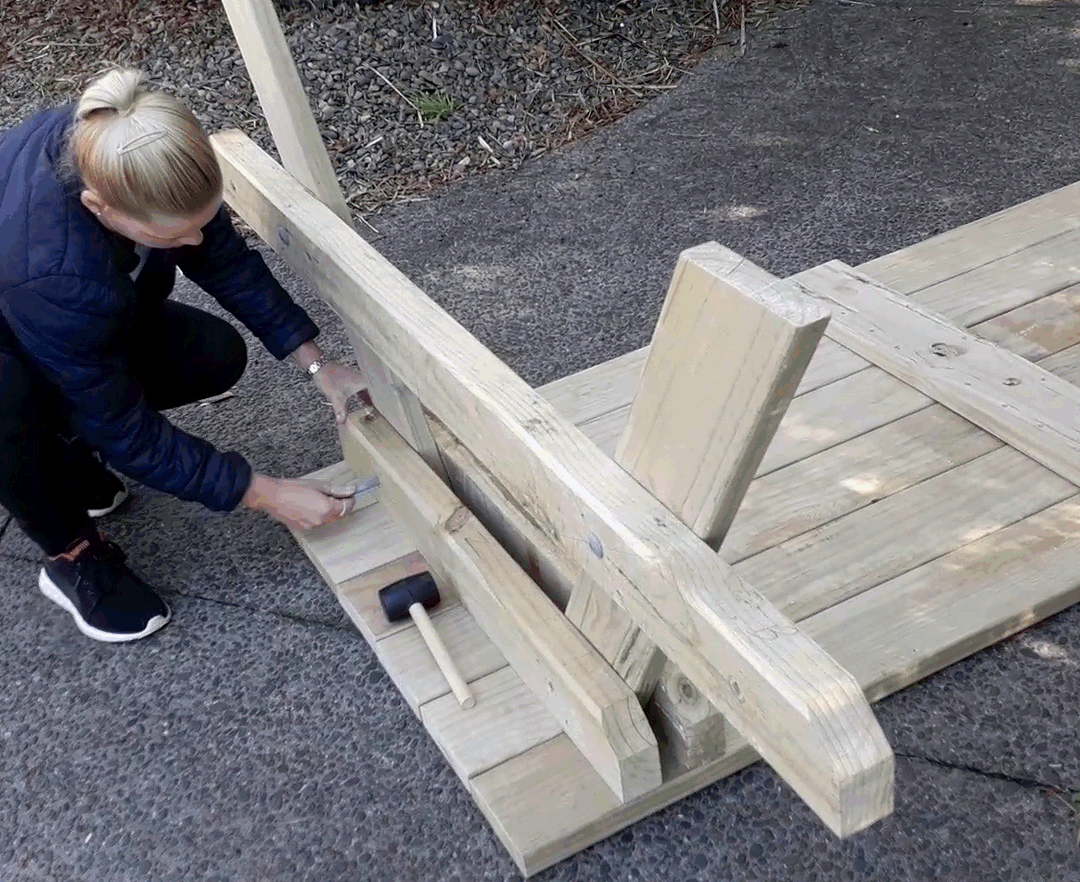 fitting the end frame of the picnic table to the tabletop