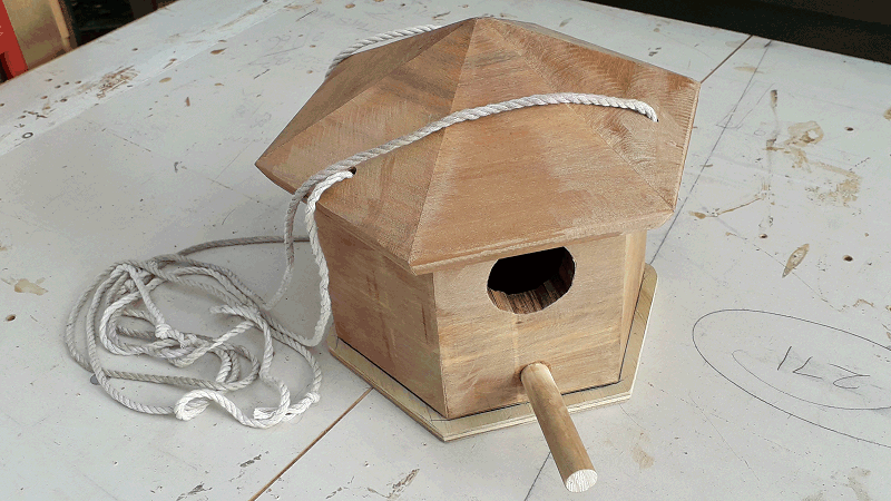 hexagonal birdshouse all ready to hang