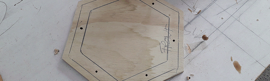 birdhouse floor marked for screw holes