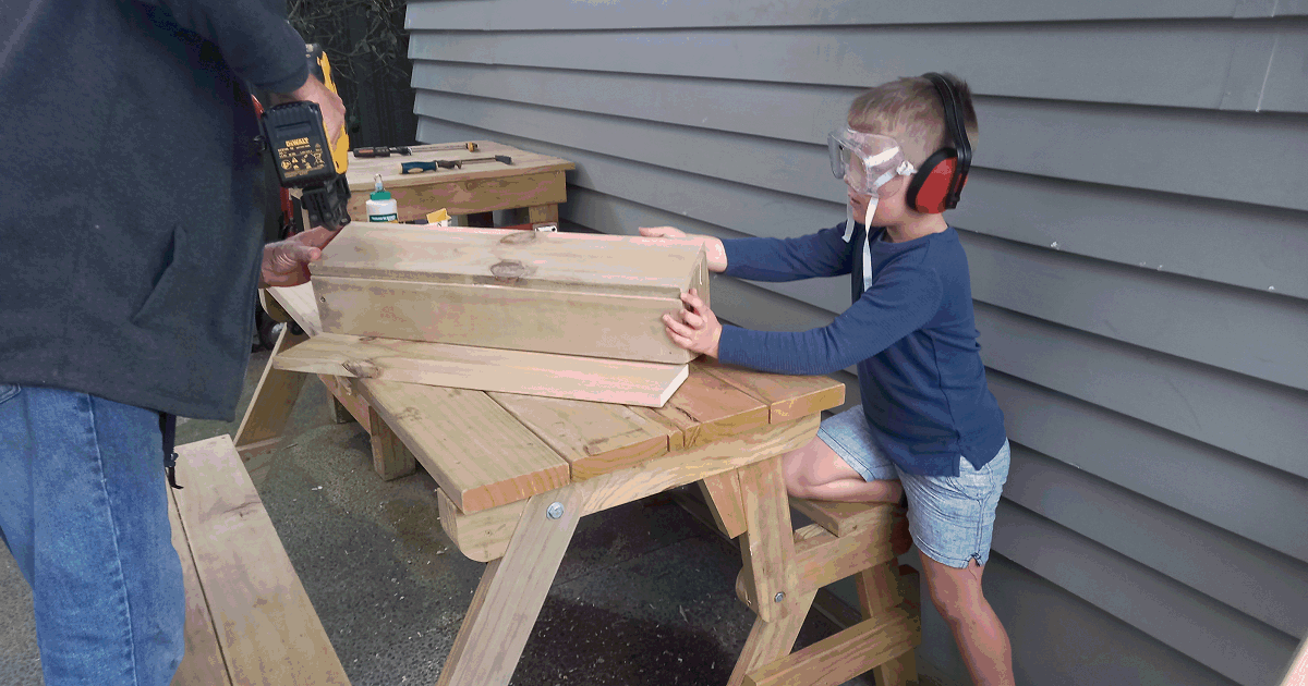 Young Carter helping make a planter box